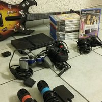 Playstation 2 slim med guitar hero och singstar samt 10 spel
