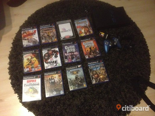 Playstation 2 spel + konsoll, kontroller och guitarr hero!